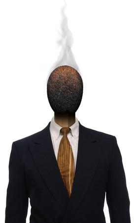 Burnt matchhead emerging from the collar of a business suit where a mans head should be photo