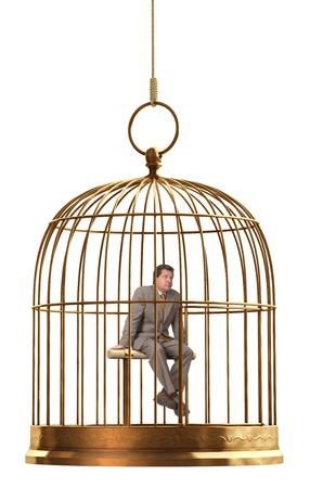 trapped: A brass birdcage hanging on a string over white