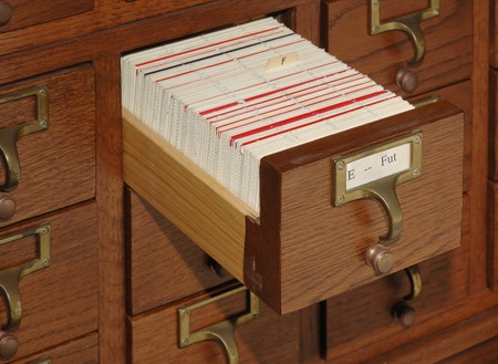 Oak card catalog file with one drawer open 版權商用圖片