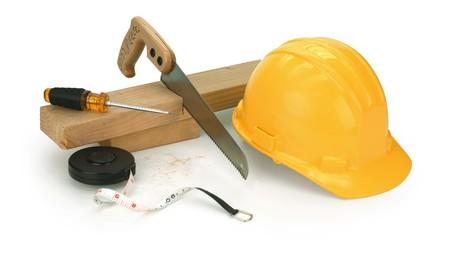 2x4: hard hat, saw, 2x4, screwdriver on white