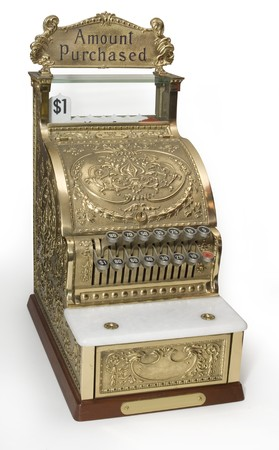 Vintage brass cash register isolated on white with clipping path photo