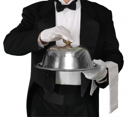service lift: Waiter with tray about to lift the silver catering dome, isolated on white