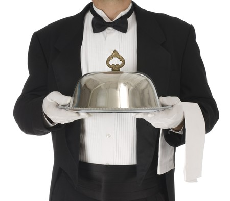 Waiter torso holding a silver tray with catering dome on a white background