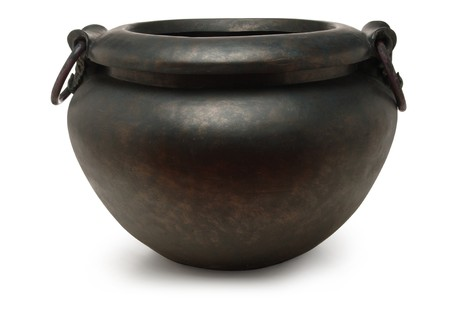 end of rainbow: black iron cauldron on white background Stock Photo
