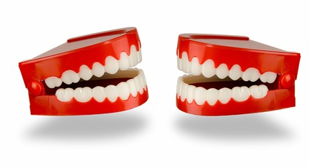 chatter: A pair of toy chattering teeth isolated on a white background