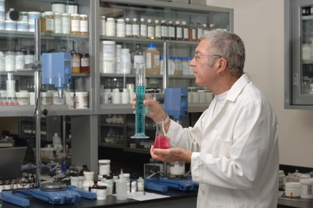 forensics: Senior chemist formulating in a laboratory
