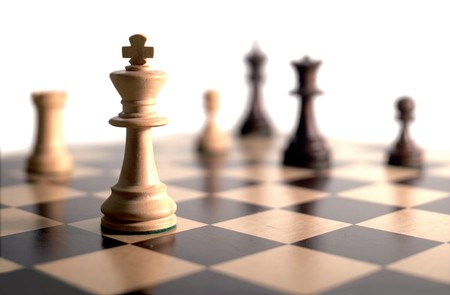 gamesmanship: chess pieces on board - white background