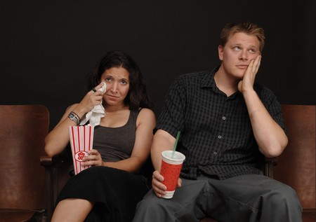 bored man: Couple on a date at the movies with a bored man and a crying woman