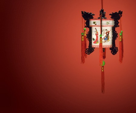 Chinese lantern hanging against a red background photo