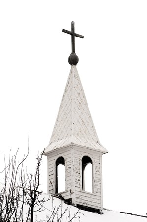 Old country church steeple on a cloudy winter day
