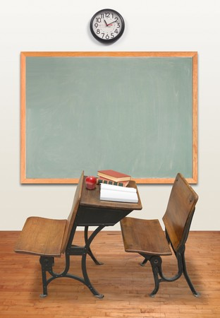 Vintage classroom with chalkboard and clock photo