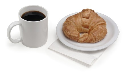 getting started: Coffee and croissant on white