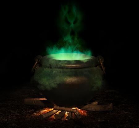 strega: bubbling calderone di ferro con spirito verde di fumo e male in aumento Archivio Fotografico