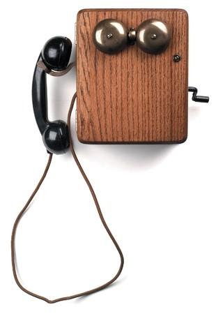 crank: antique crank telephone on white Stock Photo