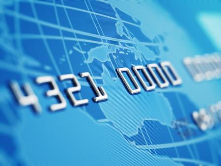 carta credito: A close up della profondit� di campo, mostrando i numeri di carta di credito fasullo. Globo e carta di credito progettato e renderd in studio. Archivio Fotografico