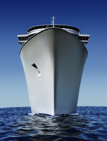 luxury white cruise ship shot from front at water level on a clear day with choppy seas and blue sky Stock Photo