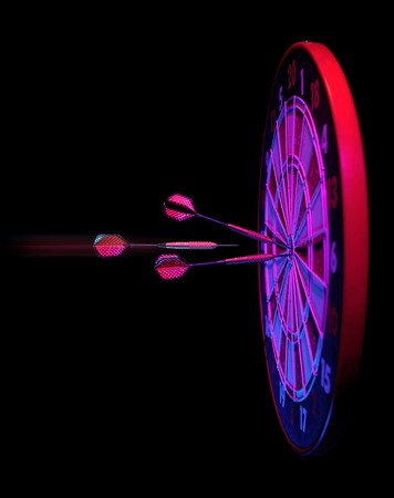 darts hitting dartboard bullseye on black Stock Photo