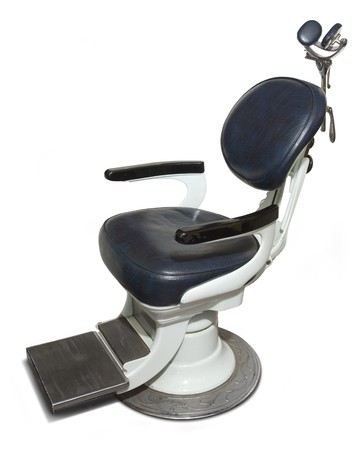 Retro dental chair isolated on a white background Stock Photo - 7052340