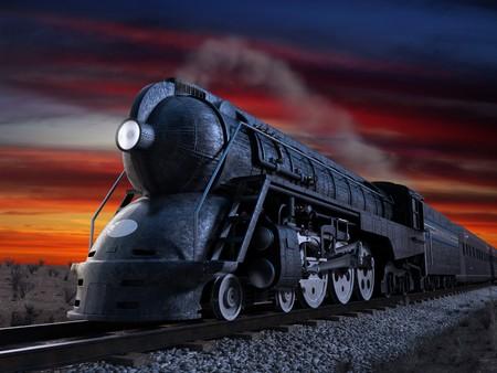locomotora: Dreyfuss J3A Streamliner locomotora conocido como the 20th Century Limited dispararon contra el crep�sculo durante una puesta de sol  Foto de archivo