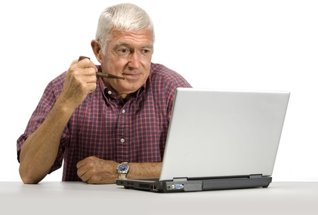 liesure: Senior man looking at a laptop on a white background