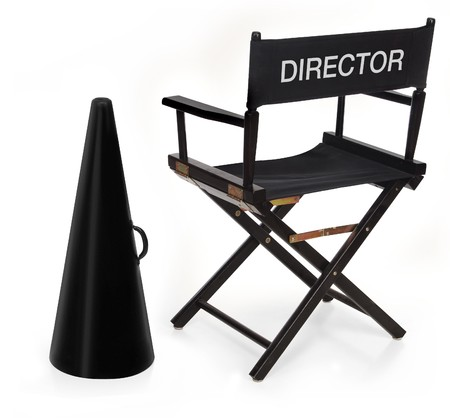 script: directors chair and megaphone on white background Stock Photo