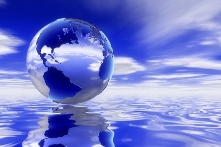 A high quality Glass 3d earth over a clean ocean reflecting the deep blue skyscape. photo