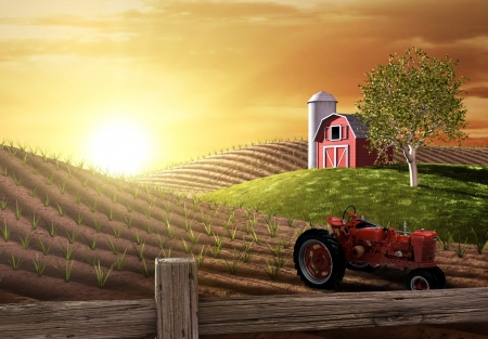Red barn and tractor on a farm with the sun rising over the horizon Banco de Imagens