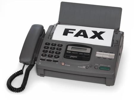 Faxgerät, die isoliert auf weißem Hintergrund