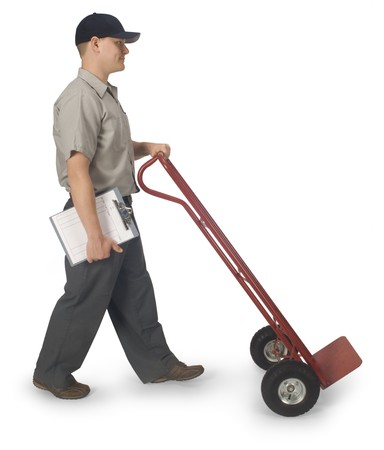 hand truck: Delivery man walking with an empty hand truck, isolated on a white background  Stock Photo