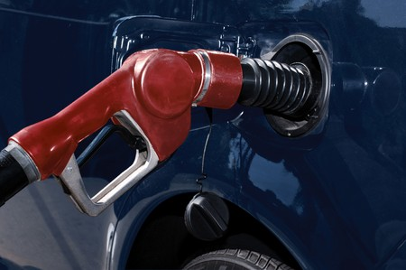 gasoline pump nozzle filling car's gas tank Stock Photo - 7055248