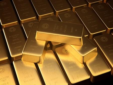 lingotes de oro: Barras apiladas de oro en lingotes.