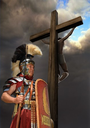roman soldier: 1st century Roman soldier in armour, rank of Optio shot against a stormy sky with Jesus on a cross in the background