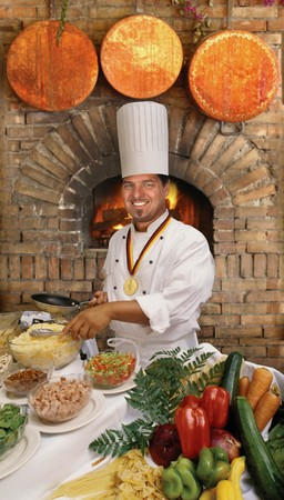 Gourmet chef preparing food in front of a brick country oven