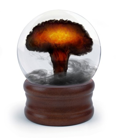 extra sensory perception: nuclear mushroom cloud appearing inside a crystal ball on white background