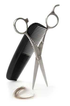 comb: Scissors and comb with a lock of hair on a white background