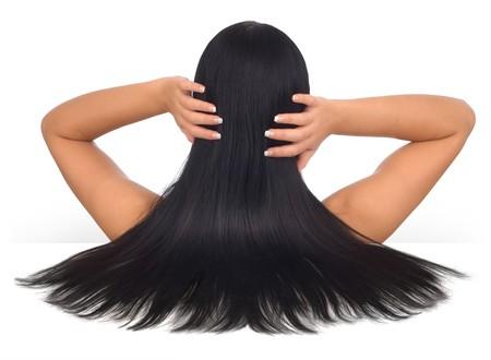 long nail: Donna con lunghi capelli neri su fondo bianco  Archivio Fotografico