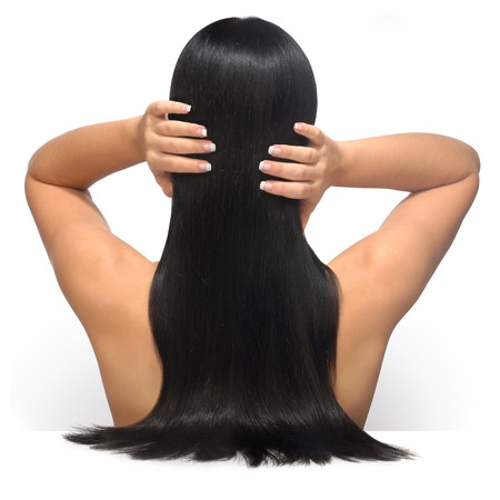 nails: Young female model with long, dark, glamourous hair and a french manicure shot facing her back against a white background