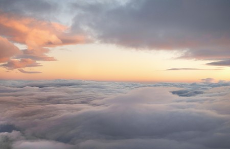 high altitude sunrise in layered cloudscape