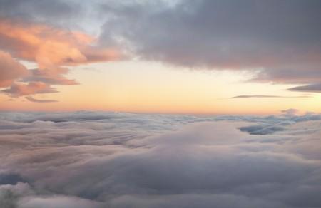 ascend: high altitude sunrise in layered cloudscape