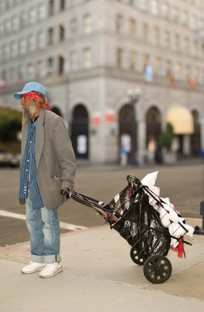 Homeless man dragging a cart in San Diego photo