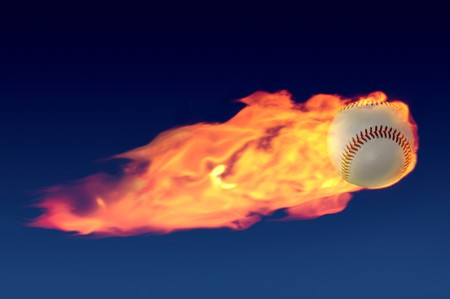 Flaming baseball shooting through a night sky  with a tail of fire