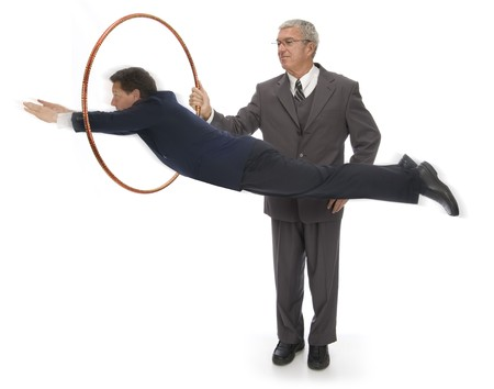 hoops: CEO holding up a hoop for his employee to jump through