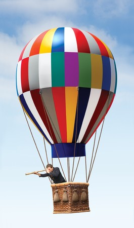 spyglass: Businessman in a hot air balloon looking with a teleescope