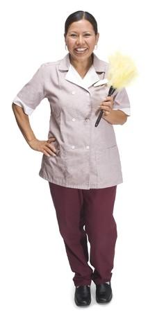 maid: Camarera de hotel femenina permanente sobre un fondo blanco Foto de archivo