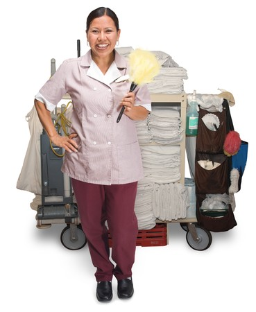 housekeeping: Female hotel maid with housekeeping cart isolated on a white background Stock Photo
