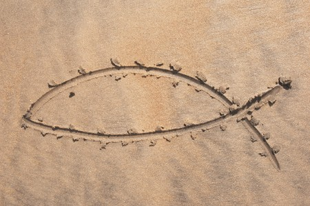 disciples: Christian fish sign drawn in sand