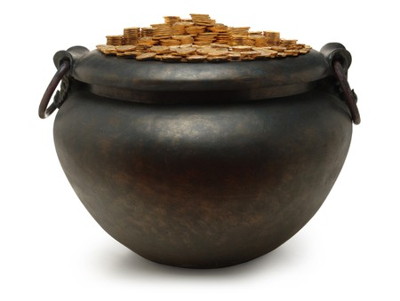iron kettle filled with gold coins on white photo