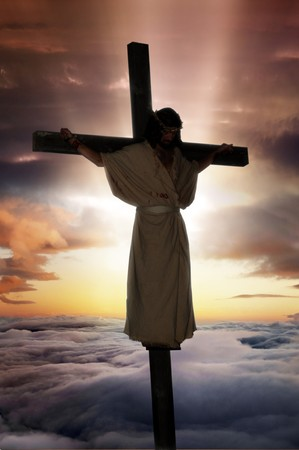 Jesus Christ on the cross with sunburst & clouds behind him. Imagens