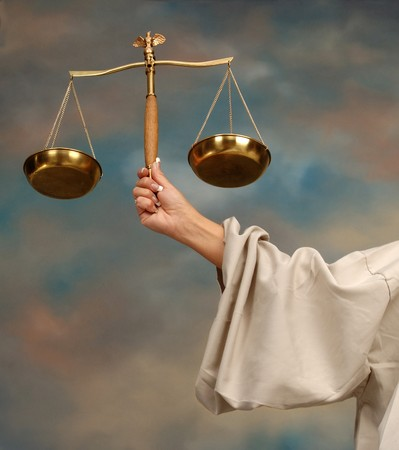 constitutional: Arm of Lady Justice holding scales Stock Photo