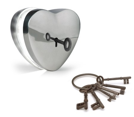 humility: key unlocking a metal heart Stock Photo